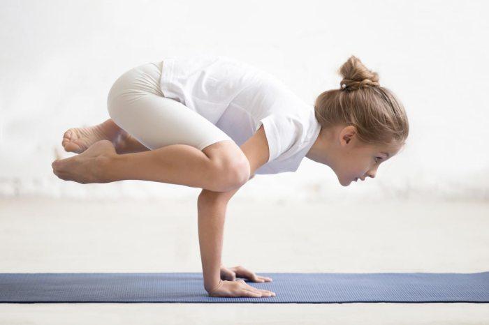 child yoga crow pose flying